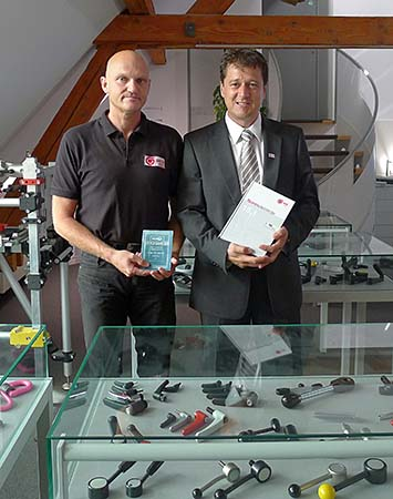 Martin Baüerle and Axel Weber with the first Otto Ganter catalog